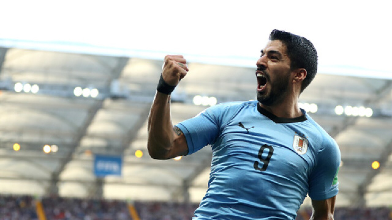 Suarez scores as Uruguay and Russia advance at World Cup