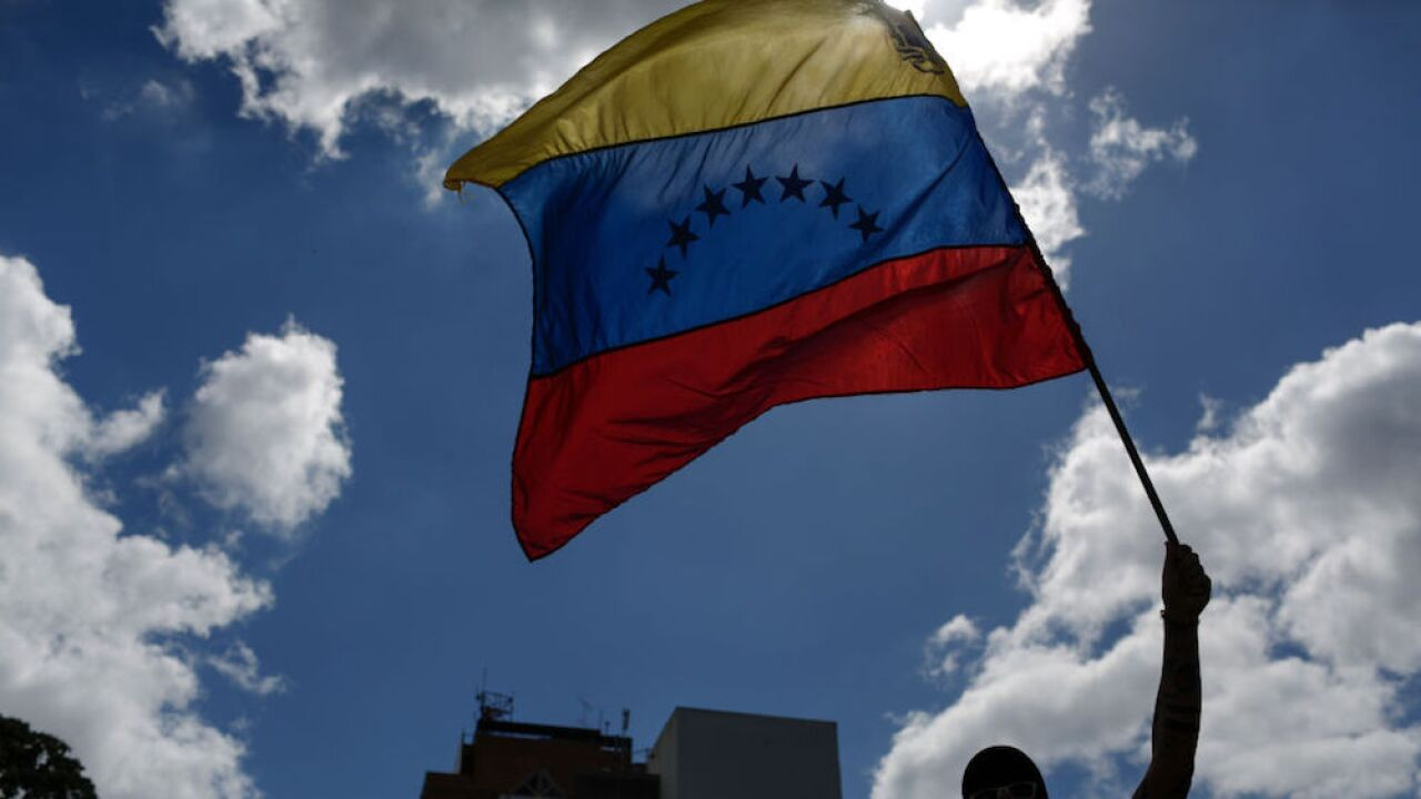 Venezuela's opposition leader calls for citizens to take to streets, government calls it a coup