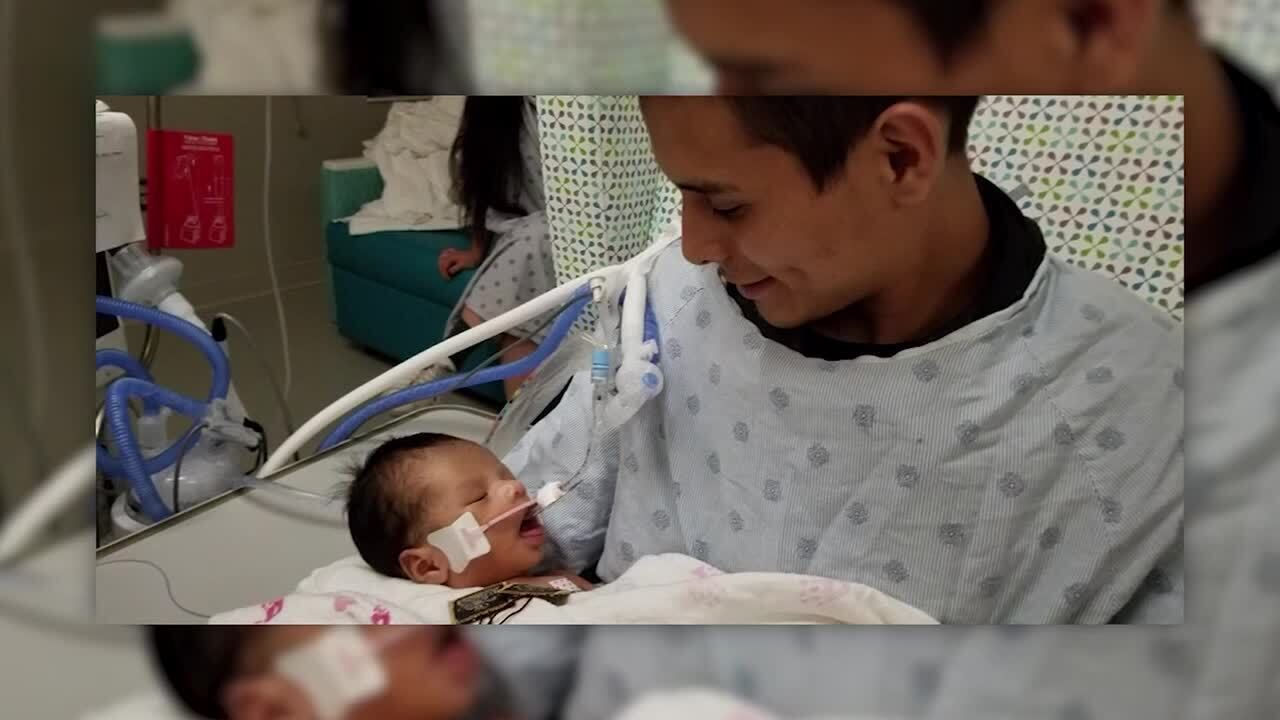 Infant cut from Illinois mother's womb opens eyes for father
