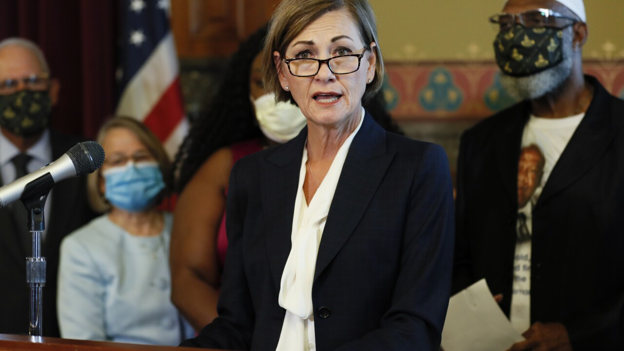 Iowa governor signs order restoring felon voting rights