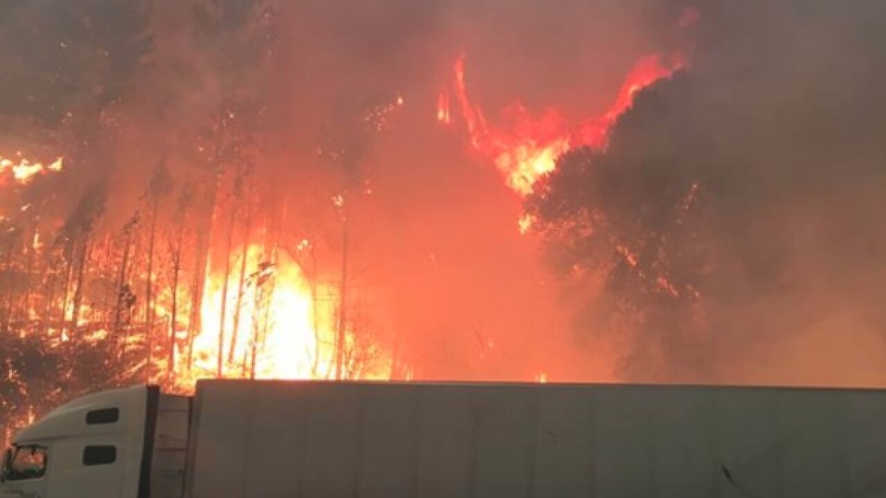 Abandoned trucks litter California highway as wildfire rages