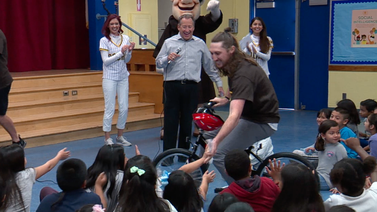 Padres players surprise San Diego elementary school students with new bikes