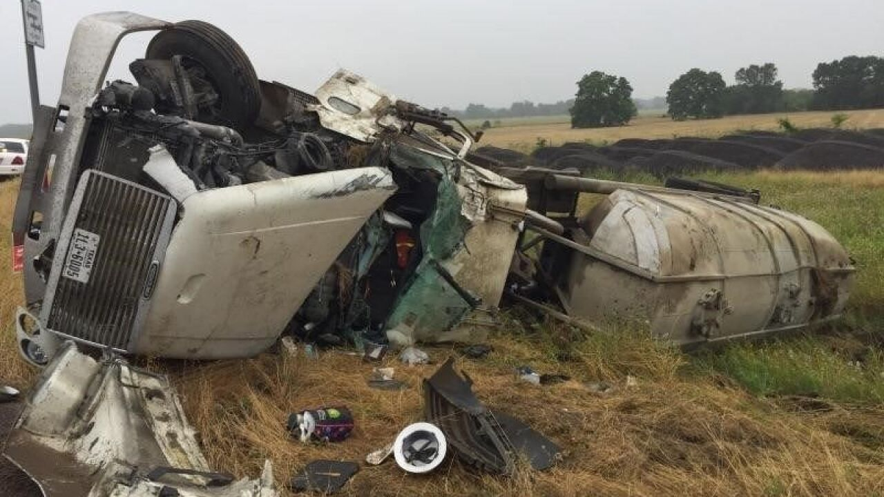 Emergency crews rescue driver after 18-wheeler rolls over