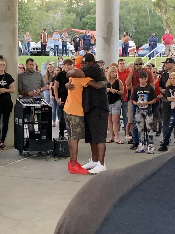 Antonio dad hugging coach