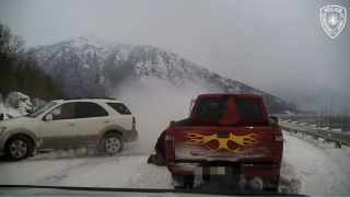 Close call: Out-of-control SUV narrowly misses tow truck driver helping stranded motorist