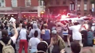 NYPD vehicle drives into crowd protesters, video shows