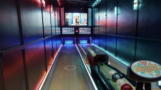 Local entrepreneur builds first-ever mobile bowling alley inside semi