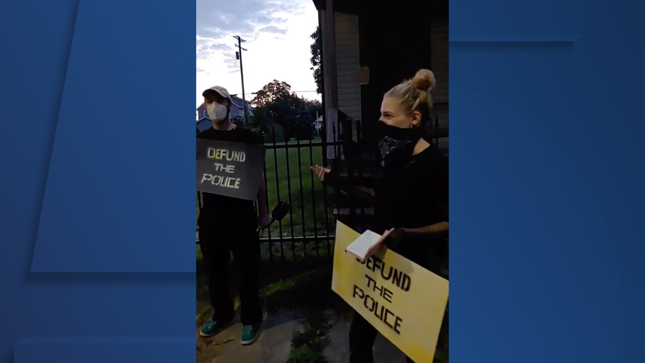 Protesters outside Mayor Frank Jackson's home on Friday.