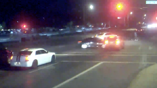 Dramatic video shows red-light runner nearly hitting family pushing stroller