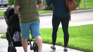April Lamb and Jason Campion push stroller outside West Boca Medical Center