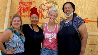 Jessica-Ann-Tyson-second-from-left-Random-Yams-of-Kindness-food-giveaway-event-for-artists-beautifying-downtown-Grand-Rapids.jpg