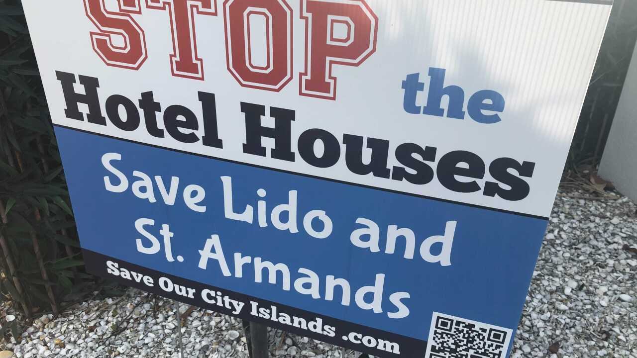 Stop the hotel houses sign