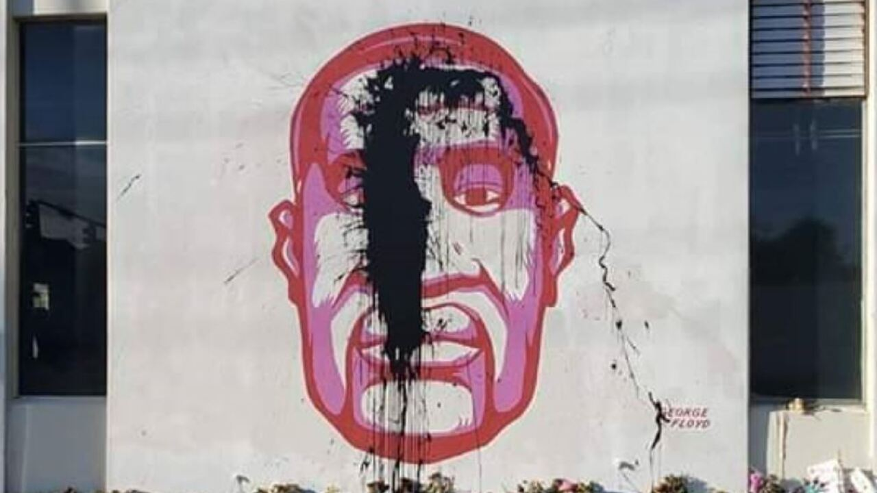 Mural of George Floyd defaced with black tar, investigated as hate crime