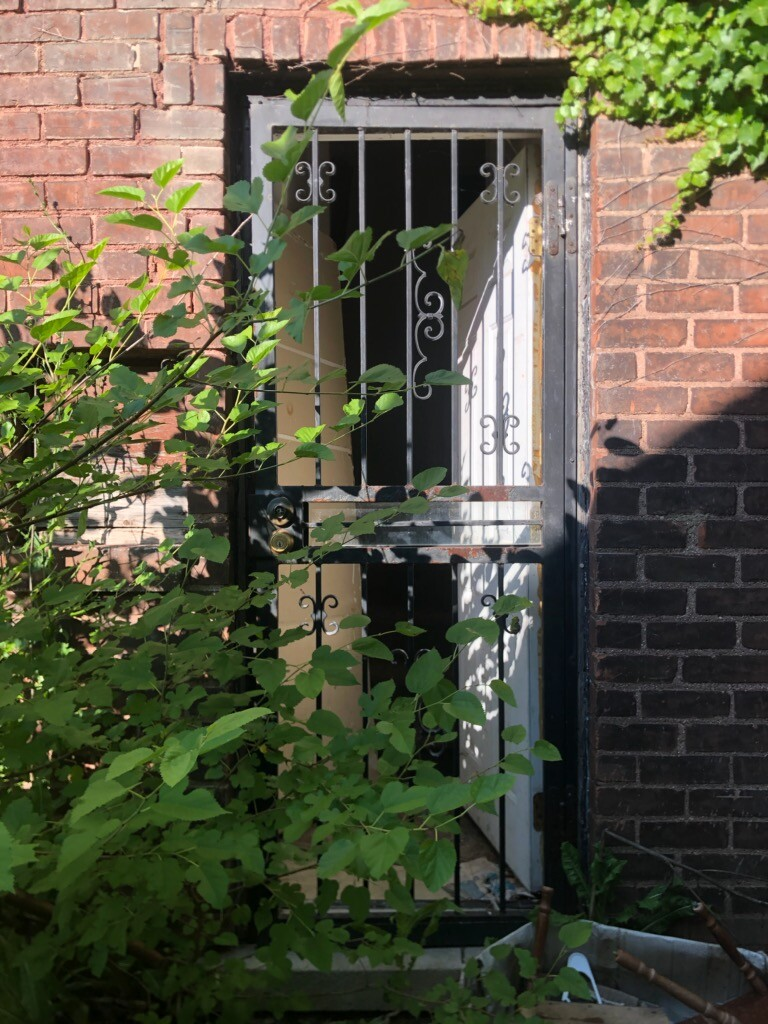 A recently busted in side-door at the house next to Vivian Gray owned by Sam Jaser.