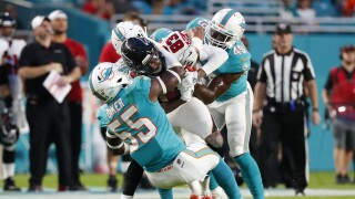 Miami Dolphins defense tackles Atlanta Falcons receiver Russell Gage in 2019 preseason
