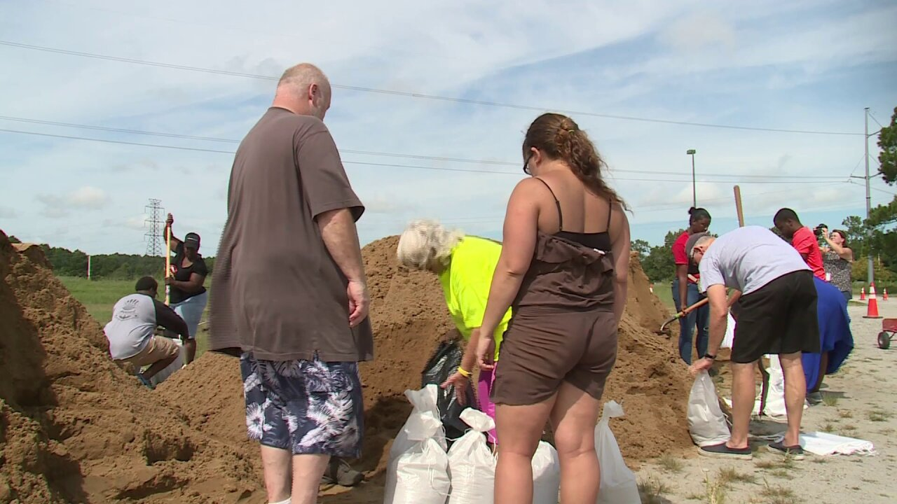 Residents shovel, bag and barrel, taking advantage of free sand in Virginia Beach