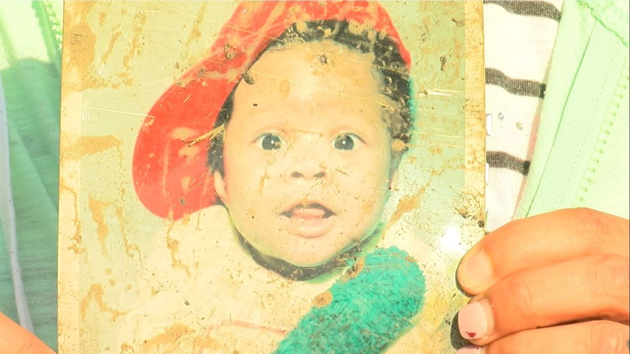 Baby picture found among charred rubble in the aftermath of apartment fire