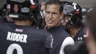 Cincinnati head coach Luke Fickell speaks with quarterback Desmond Ridder