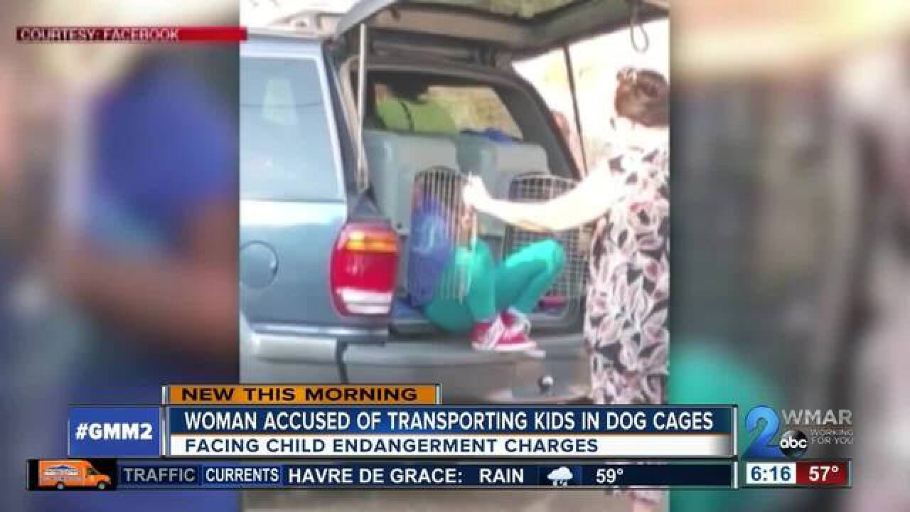 Woman accused of driving children in kennels
