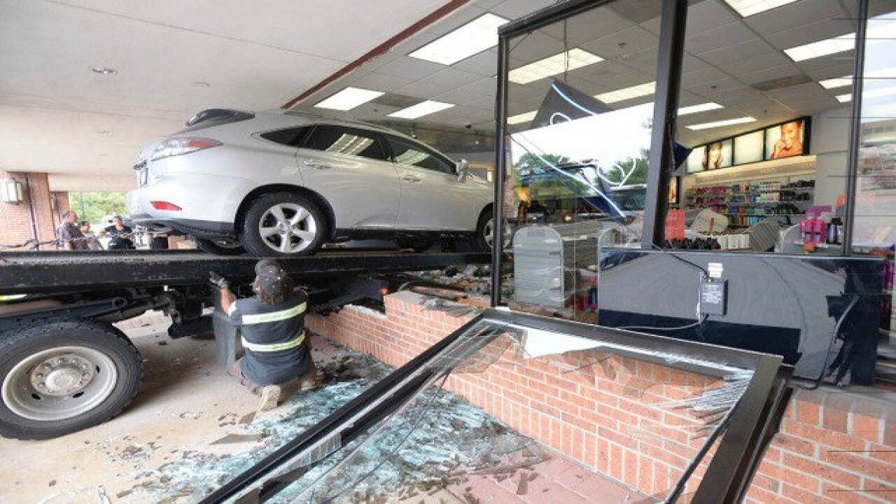 Elderly driver cited after crashing into store