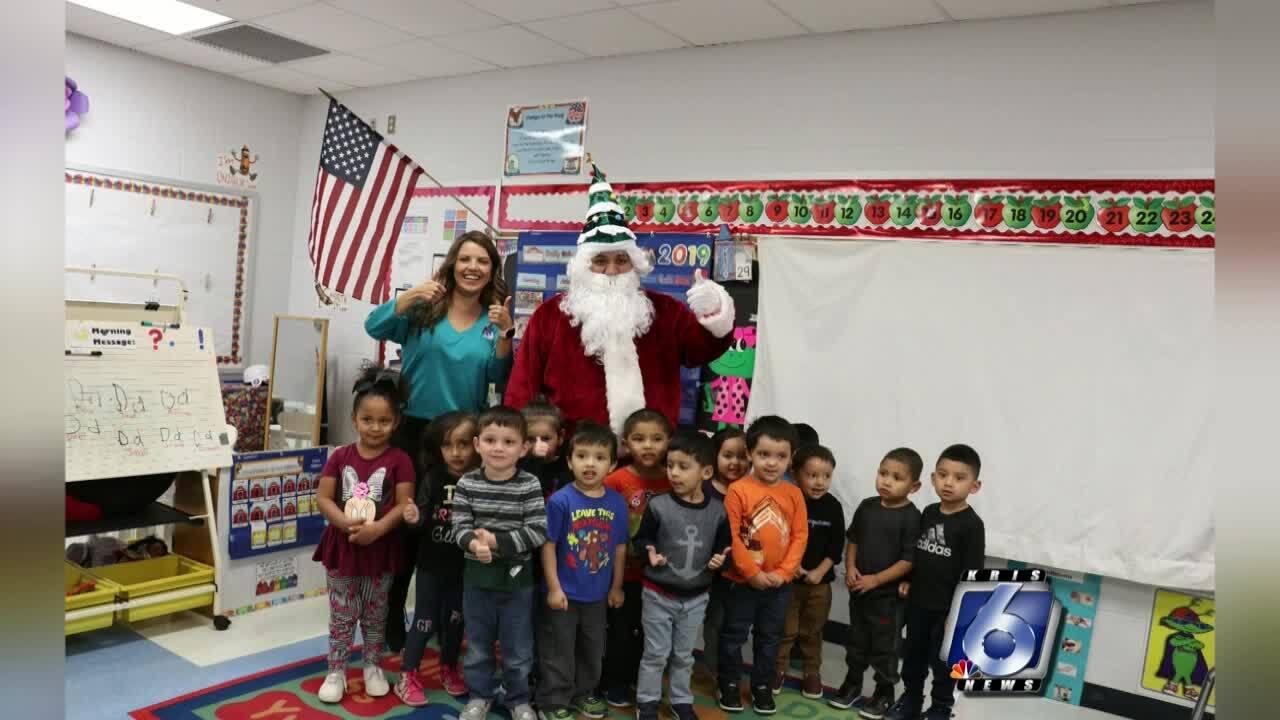 Santa Claus and Katia Uriarte visit Zavala Elementary School