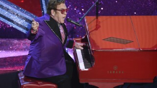 Elton John announces new dates for final tour postponed by coronavirus
