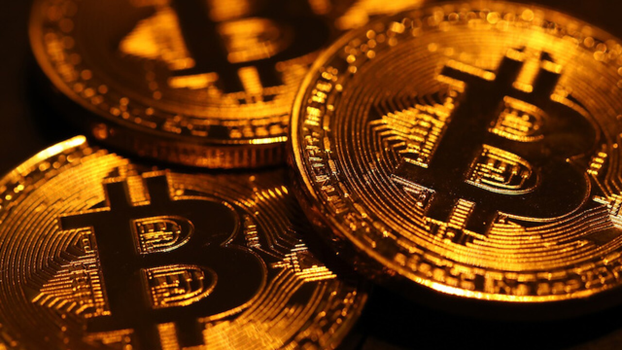 Bitcoin plunges more than $3K after hitting new record