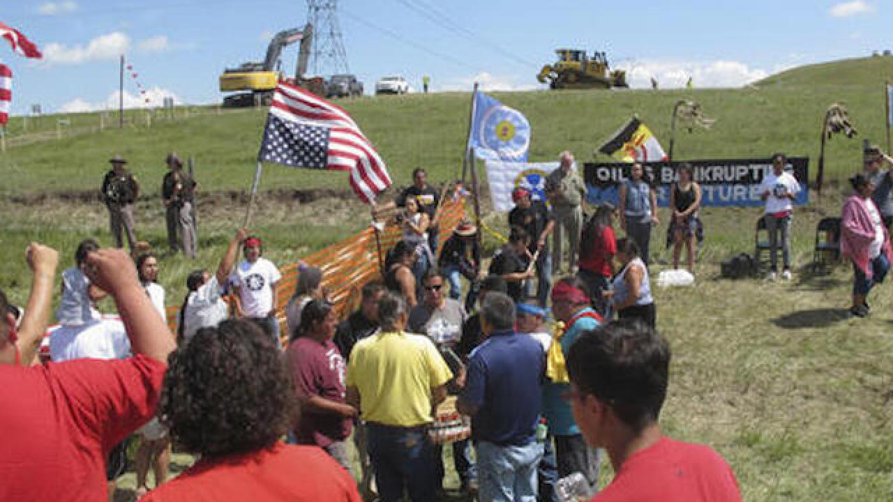 Upset with oil pipeline over burial ground, protests turn violent