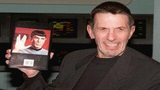 Leonard Nimoy holds up copy of 'I Am Spock' autobiography