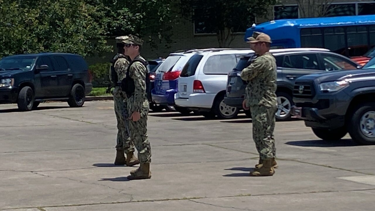 U.S. Navy personnel at Martin Middle School during bomb search