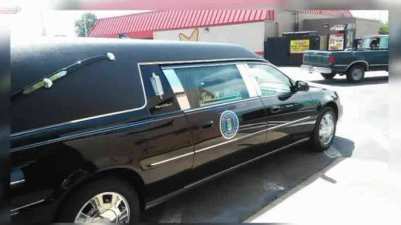 Hearse with veteran's flag-draped coffin left in fast-food parkinglot