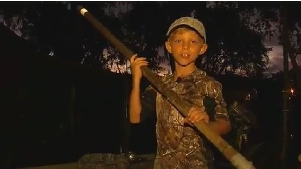 8-year-old Florida boy catches 11-foot gator