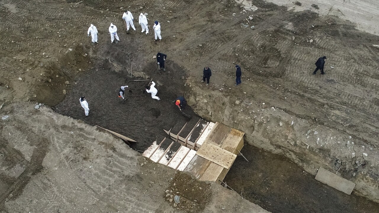 New York shortens deadline for claiming dead, photos show mass burials on Hart Island