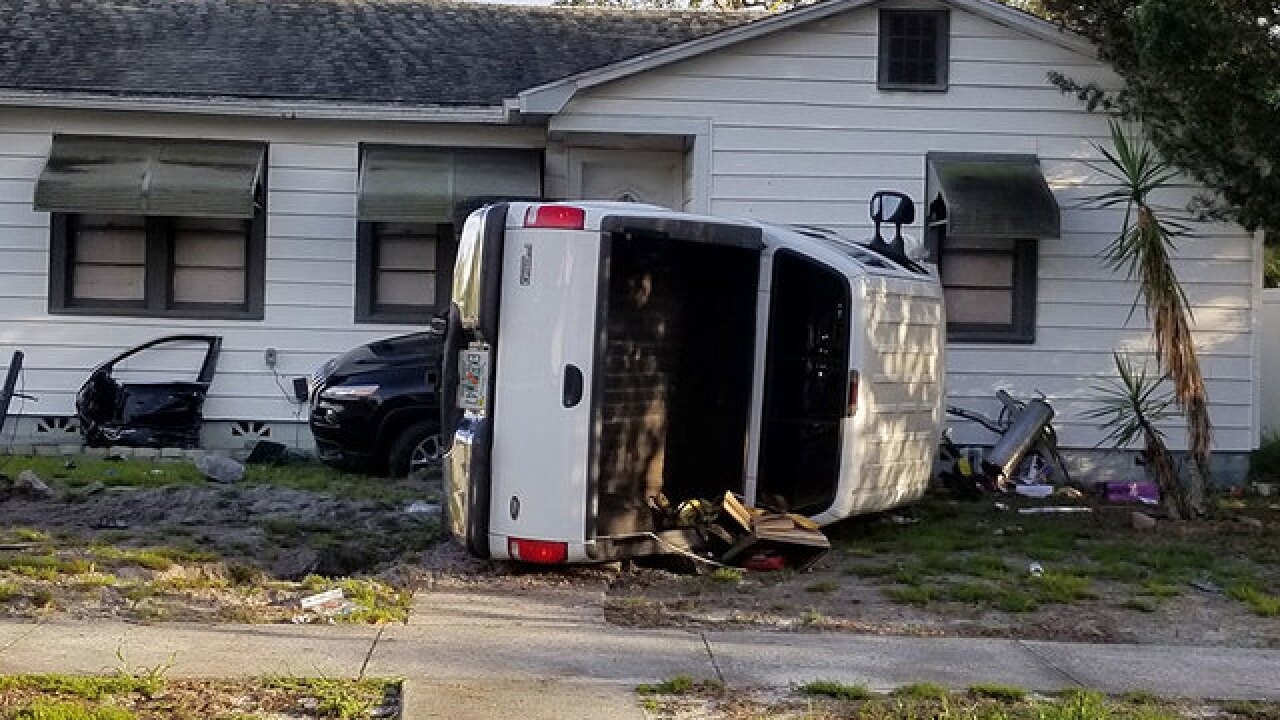 Two vehicles collide, crashing into house