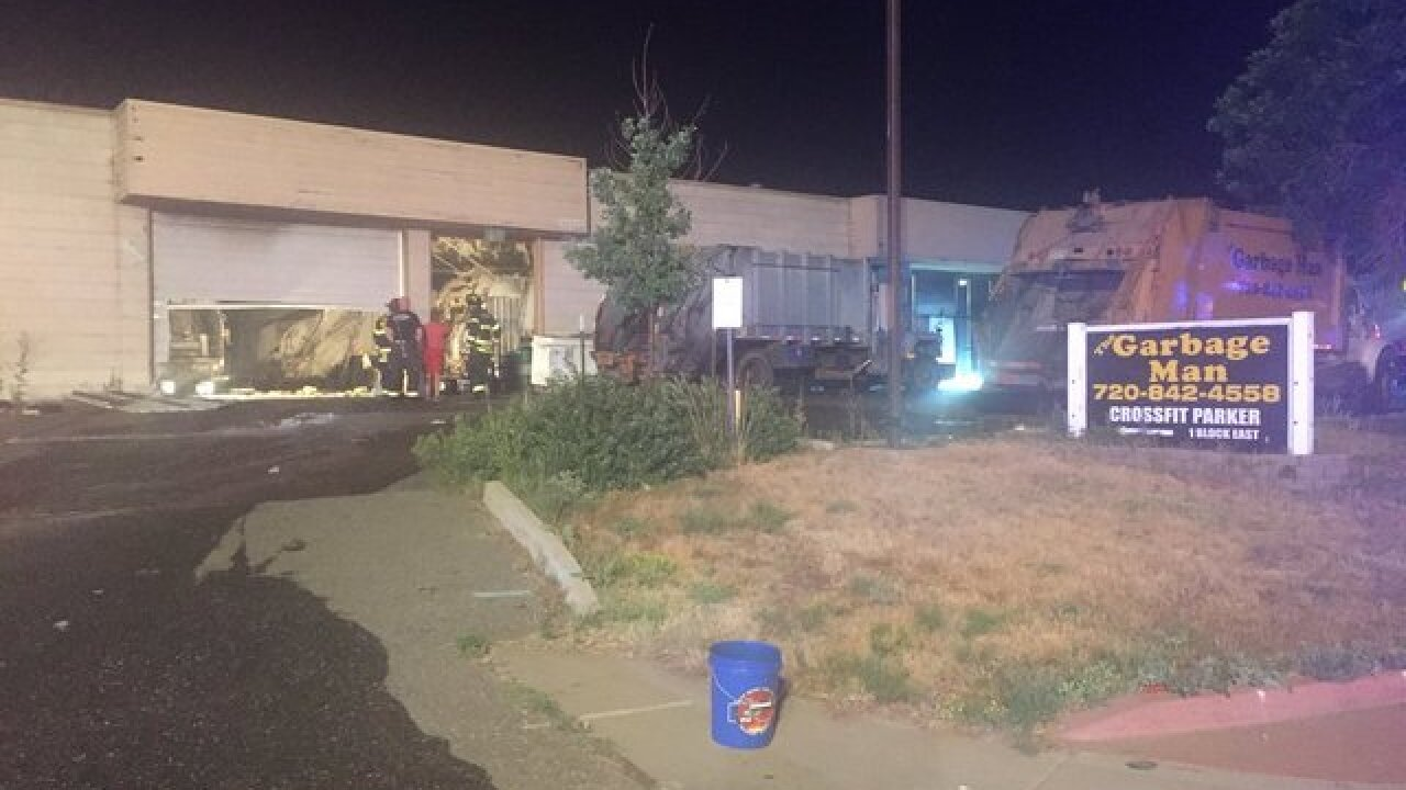 Fire rips through garbage truck warehouse in Parker