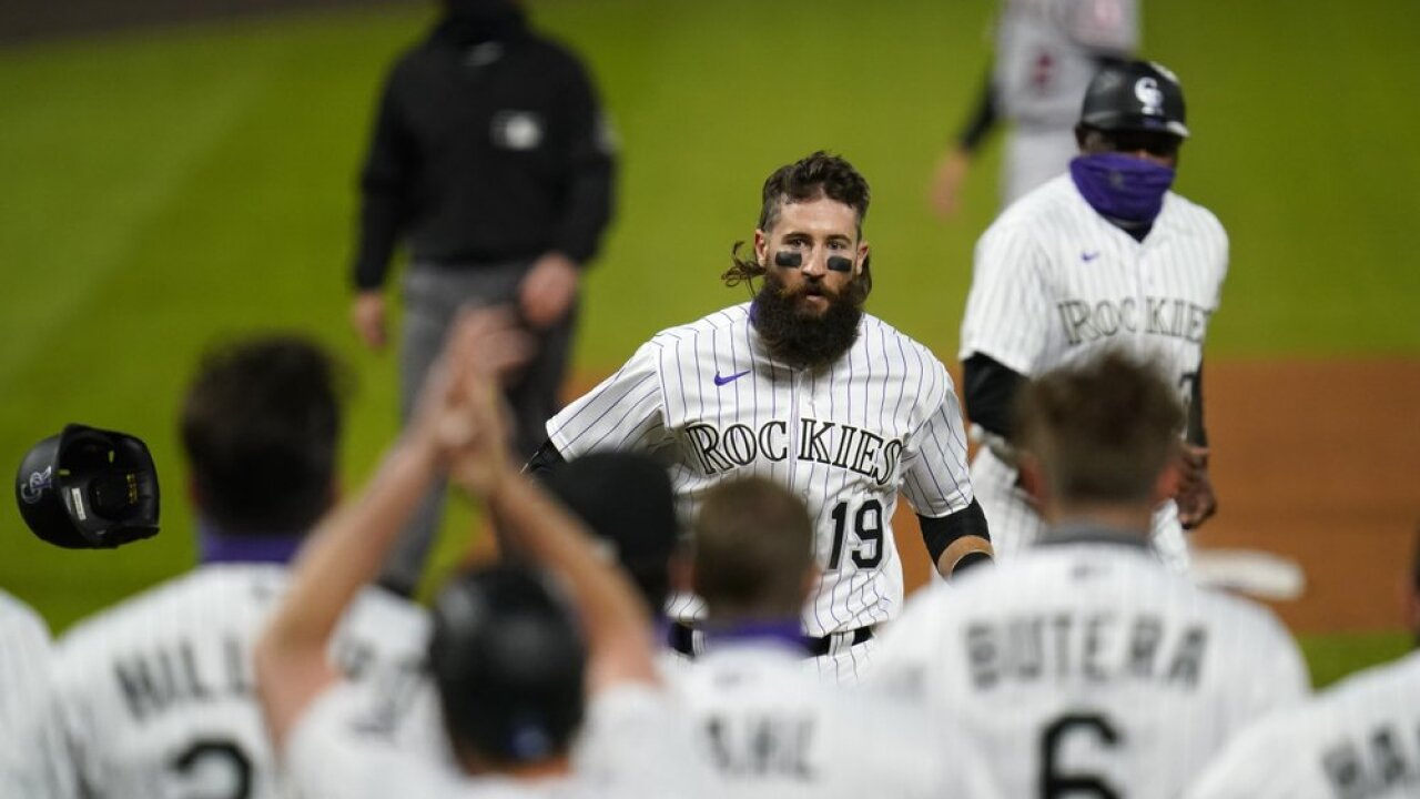Blackmon 2-out slam caps 5-run rally in 9th, Rox beat Angels
