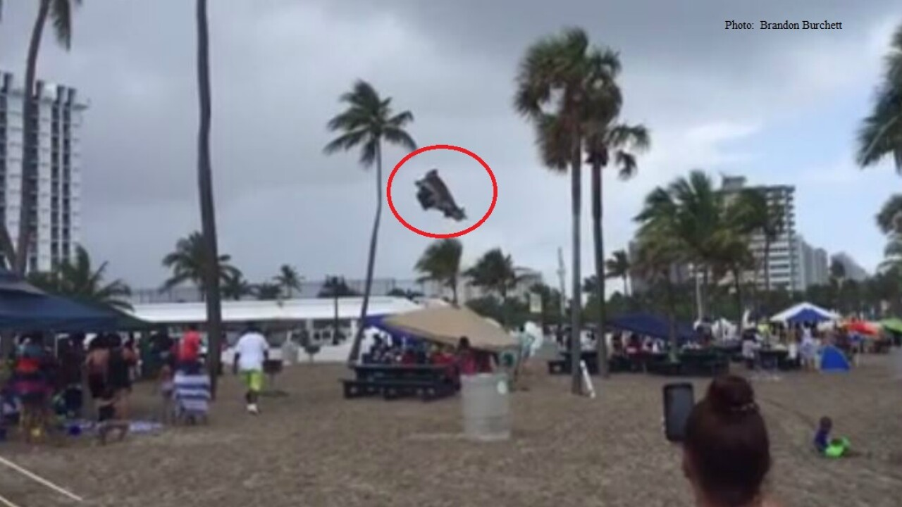 Three children hurt after waterspout come ashore, sends Fla. beach bounce house into theair