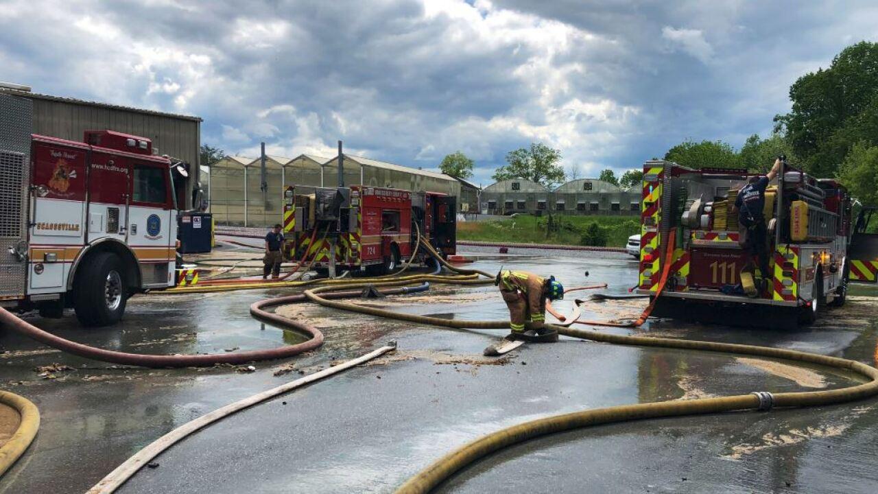 Crews battle two alarm fire at Bell Nursery