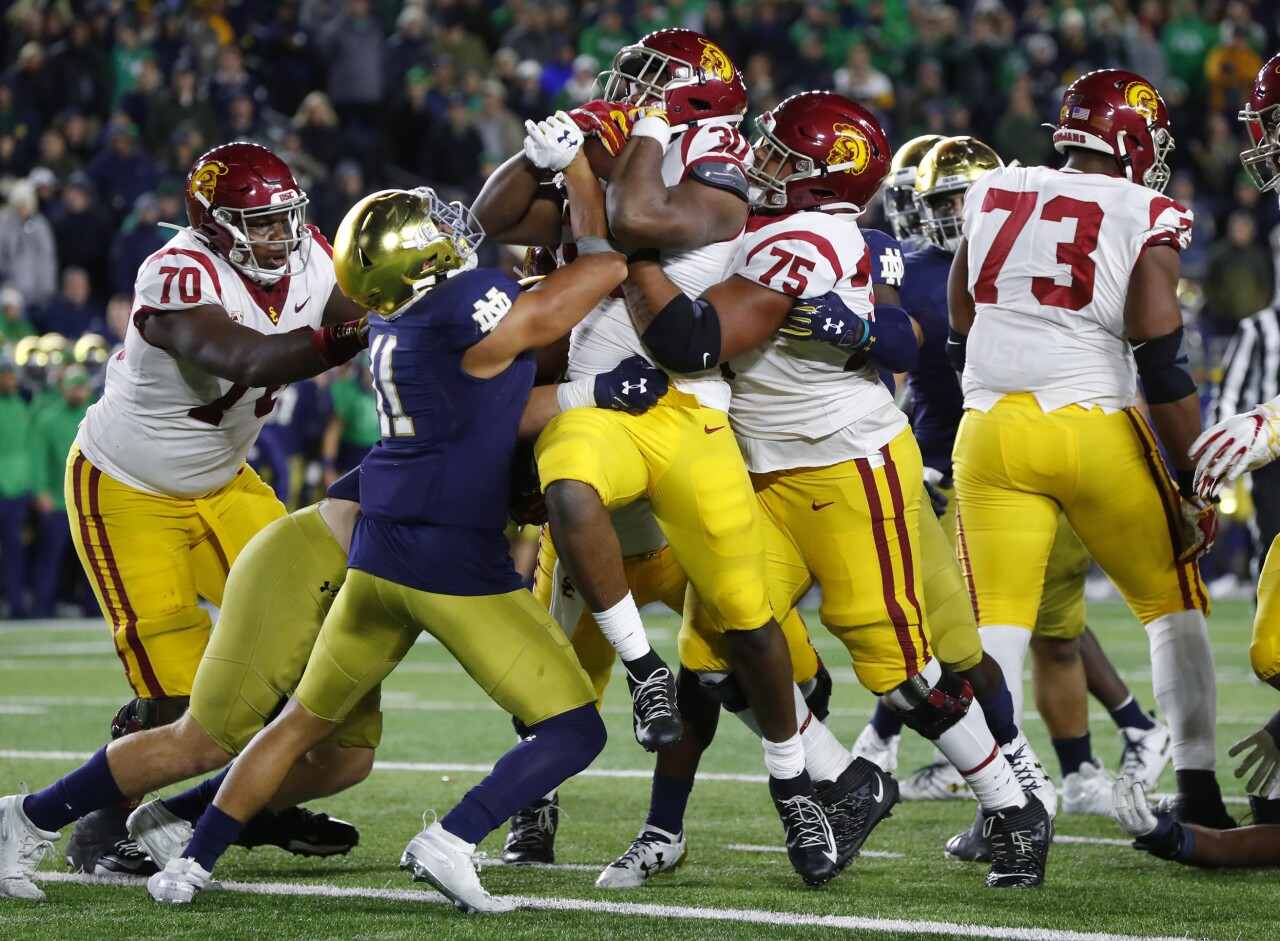 USC Trojans running back Markese Stepp lifted into end zone vs. Notre Dame Fighting Irish in 2019