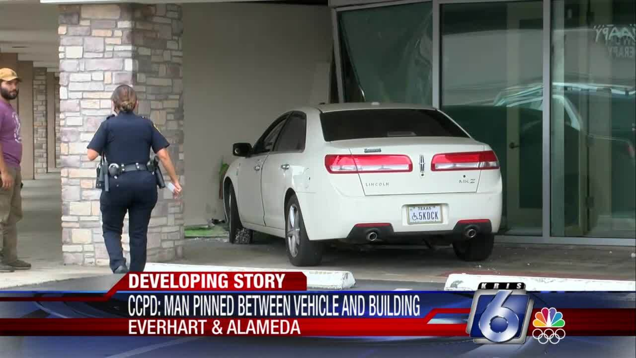 Man injured when pinned between wall and vehicle