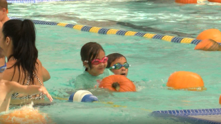 """On Sunday, the pool at the Lompoc Aquatic Center was transformed into a floating pumpkin patch for the first ever """"Dunkin for Pumpkins"""" event."""