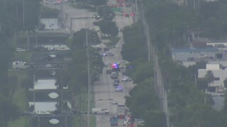 Doral police respond to Northwest 92nd Avenue and Northwest 25th Street on Oct. 22, 2021 after two officers were shot.jpg