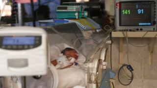 Baby in hospital bed