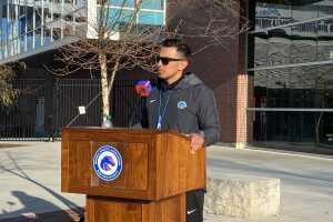 Boise State football head coach Andy Avalos behind a podium near Albertsons Stadium.