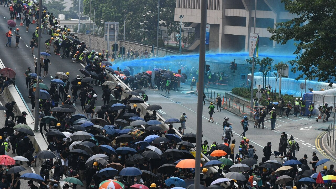 Hong Kong police fire tear gas, water cannon at protesters, days ahead of China's 70th anniversary celebrations