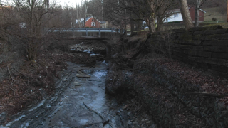 Taylor Mill resident Bill Hall's backyard is slowly being eroded by an overflowing creek