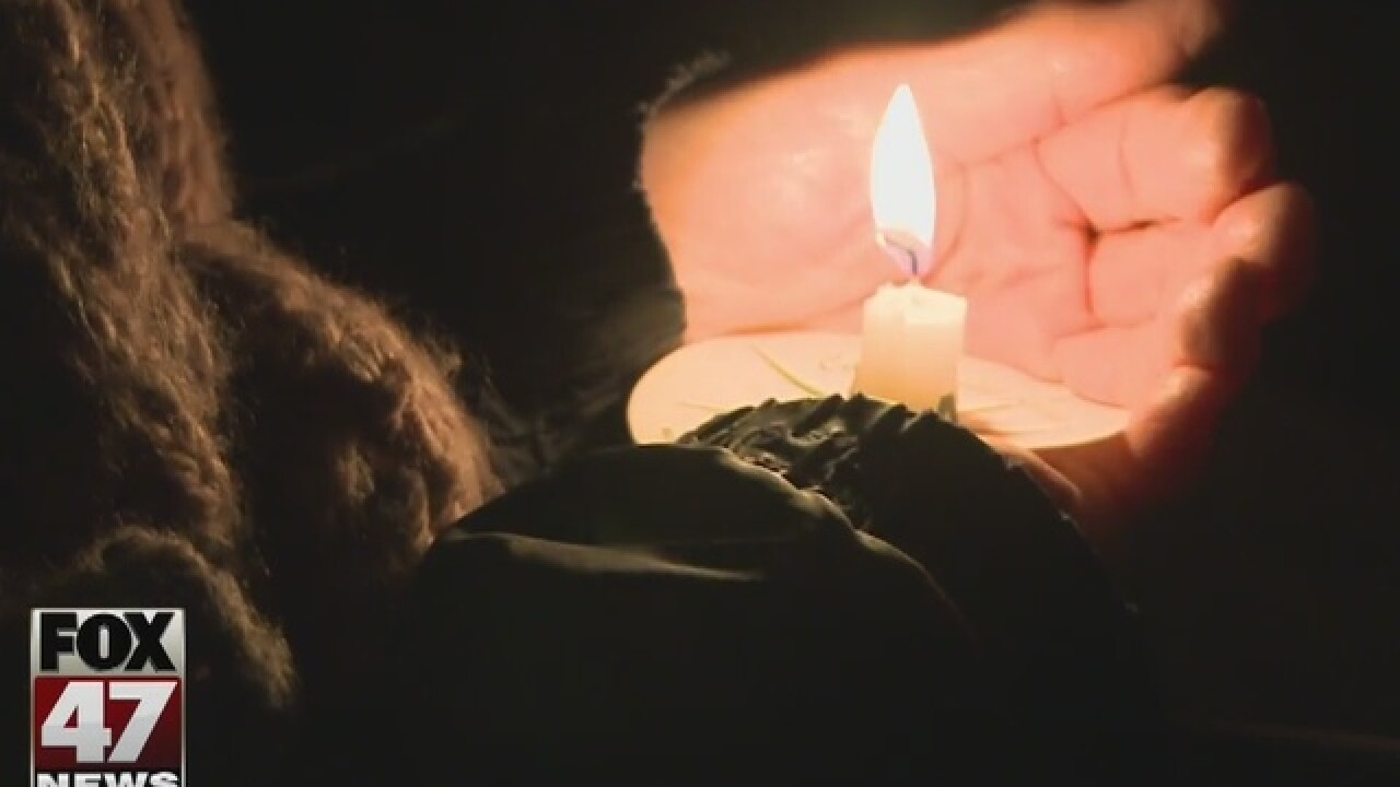 Kalamazoo honors victims in candlelit vigial