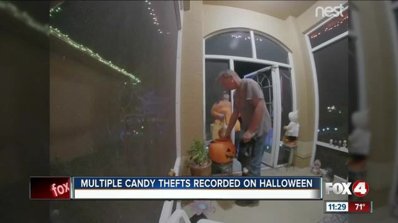 Adults seen on camera stealing Halloween candy