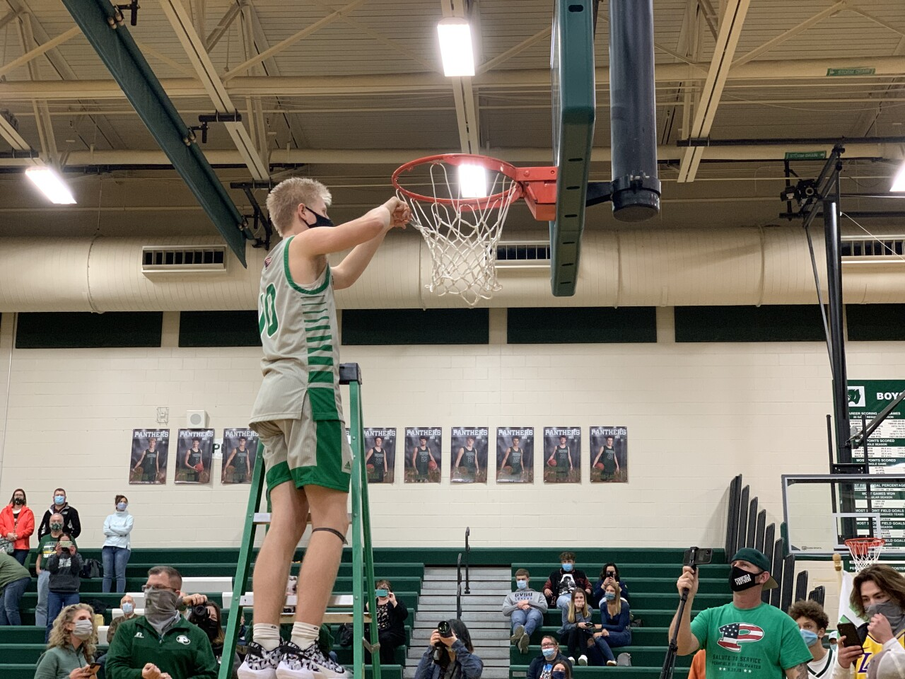 Junior guard Aiden Burns cuts down his portion of the net