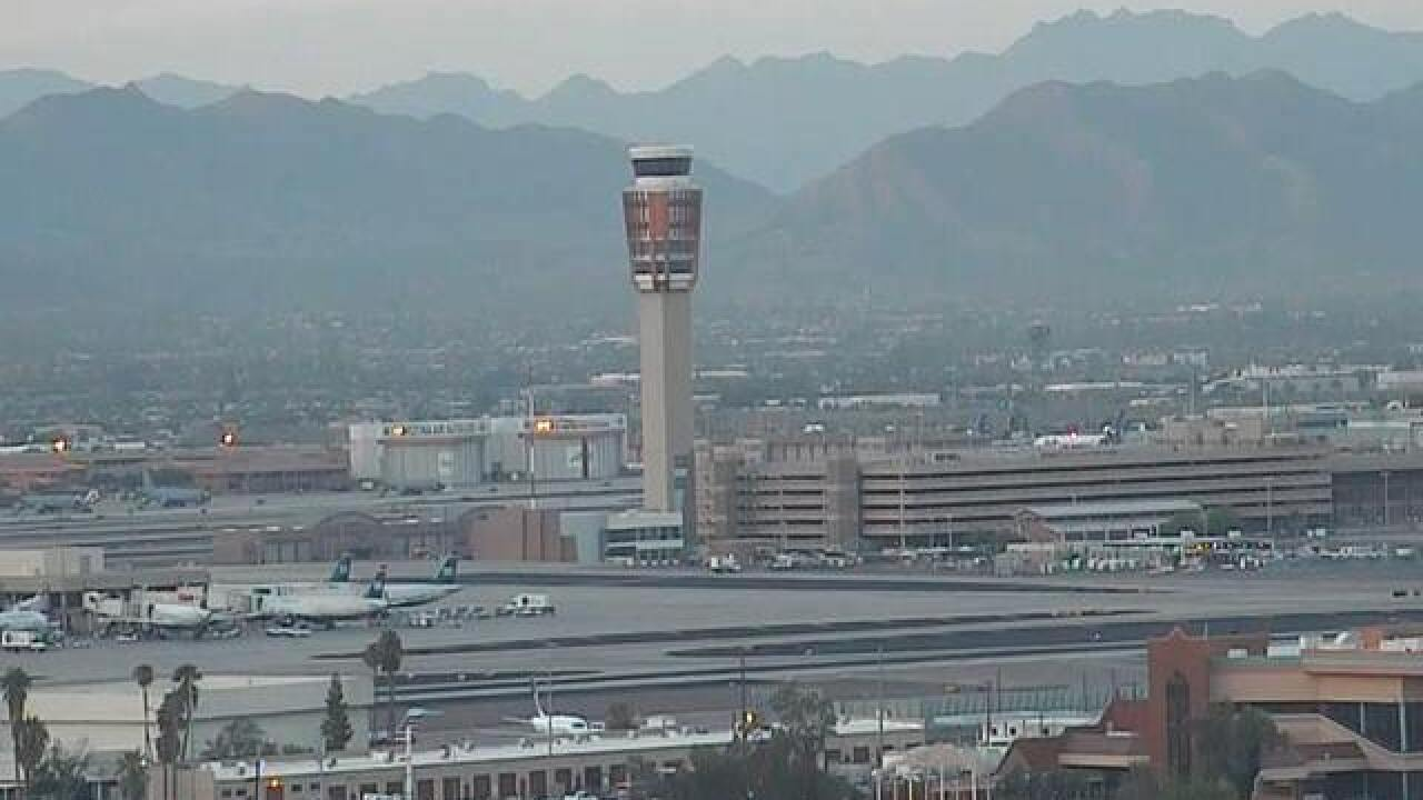 Plane returns to Phoenix after several passengers become ill